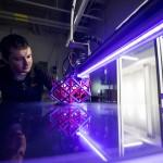 Collaboration - Wichita State technician using 3D printer